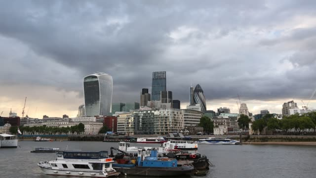 twenty fenchurch street, the leadenhall building, and the swiss re tower in the city of london from the south bank of the river thames, united... - overcast stock videos & royalty-free footage