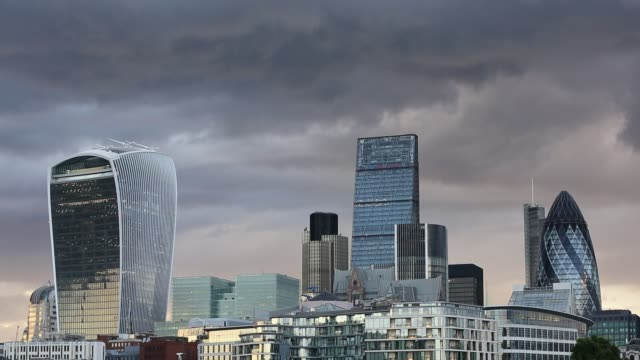 twenty fenchurch street, the leadenhall building and the swiss re tower in the city of london from the south bank of the river thames, uk. - city of london stock videos & royalty-free footage