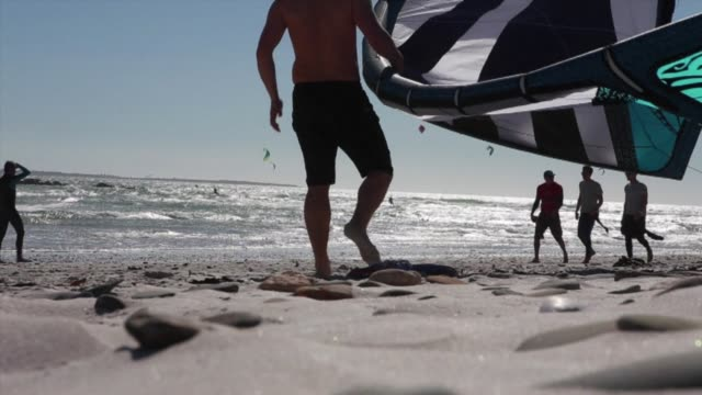 twenty four of the worlds best kiteboarders take to the water in cape town for red bulls extreme king of the air competition - new york red bulls stock videos and b-roll footage