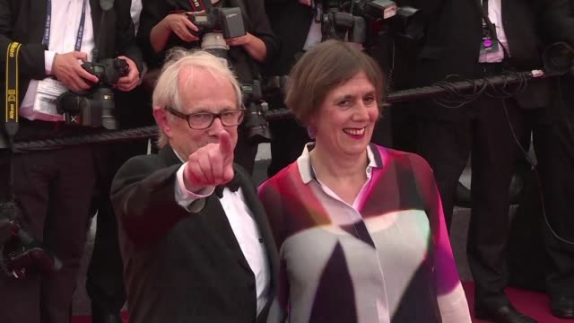 Twenty one films were vying for the Palme d Or but British director Ken Loach claimed the top prize at Cannes Sunday for the second time in a decade...