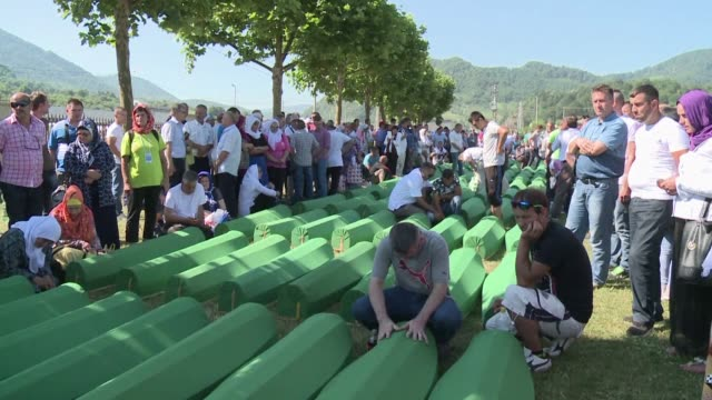 twenty one years after they were killed in europes worst massacre since world war ii the remains of 127 people were finally laid to rest monday in... - srebrenica stock videos and b-roll footage