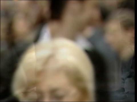 vídeos de stock e filmes b-roll de twenty years since first hiv diagnosis; lib england: ??? / ext slow motion blurred seq people along street - retrovírus