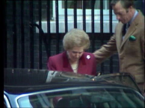 twentyfive years since margaret thatcher became pm lib london ext tearful margaret thatcher in red suit along to car after leaving no 10 downing... - メアリー ナイチンゲール点の映像素材/bロール