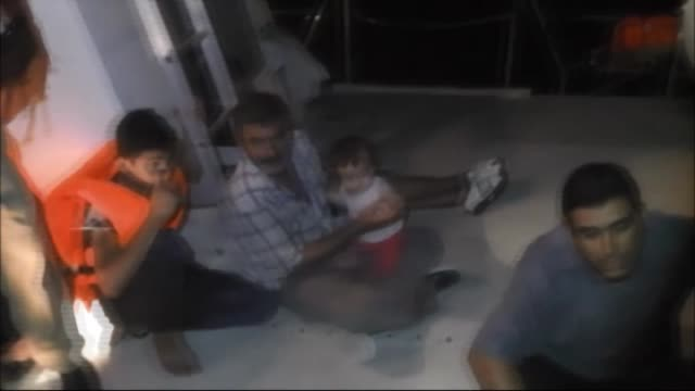 twentyfour syrian refugees seen on august 22 2016 in mersin south of turkey after they were rescued by members of turkish coast guard command from a... - fibreglass stock videos and b-roll footage