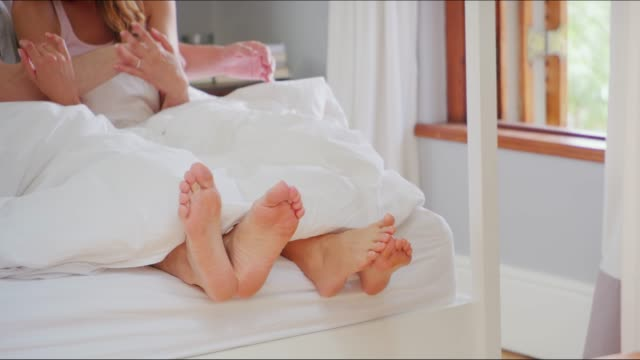 twiddling their toes - heterosexual couple stock videos & royalty-free footage