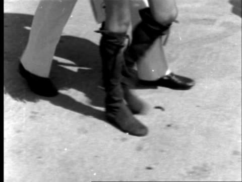twiggy leaves lap airport to head to america england london lap twiggy tilt roman sandals to bv cms poses on steps turns to bv up neg 16mm brenards... - sandal stock videos & royalty-free footage