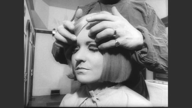 twiggy walks into london's first wig clinic / simon hext wig surgeon removes wig from twiggy's head / wig placed on pseudo operating table and teams... - 1966 stock videos & royalty-free footage