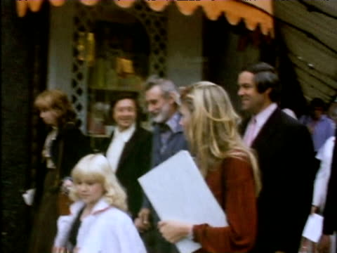 twiggy walks to entrance of harrods department store to present petition protesting at store trading in products made from animal skin 1975 - twiggy fashion model stock videos and b-roll footage