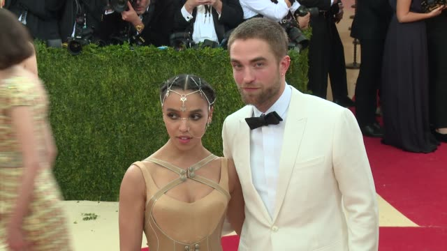 twigs, robert pattinson at manus x machina: fashion in an age of technology - costume institute benefit gala - arrivals at metropolitan museum of art... - gala stock videos & royalty-free footage