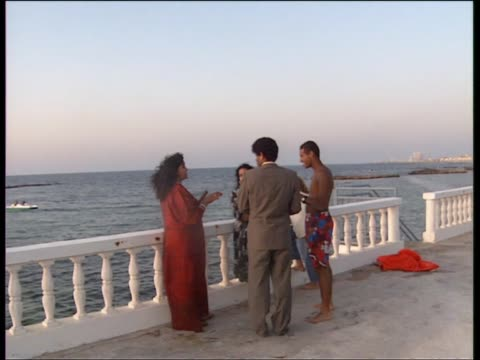 Twilight at Muammar Gaddafi's seaside compound in Tripoli / Gaddafi with family including wife Safia and daughter Aisha and friends relaxing and...