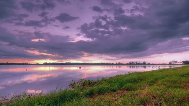 twilight sunset with cloud motion at lake - high dynamic range imaging stock videos and b-roll footage