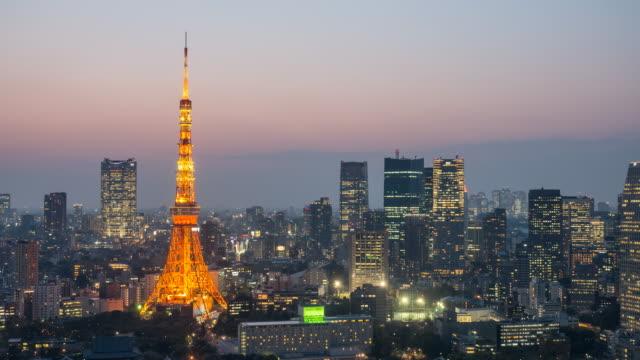トワイライト ・ タイム東京タワー都市景観夜に時間経過日 - 昼から夜点の映像素材/bロール