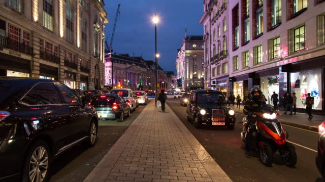 Twilight time lapse of rush hour traffic along Piccadilly near Piccadilly Circus in Central London, taken from the traffic divider