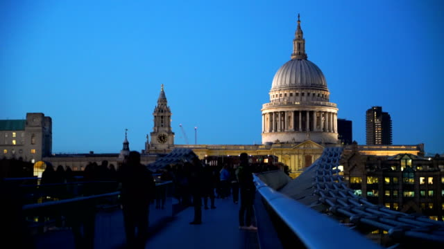 twilight timelapse of millennium bridge in london, uk - st. paul's cathedral london stock videos & royalty-free footage