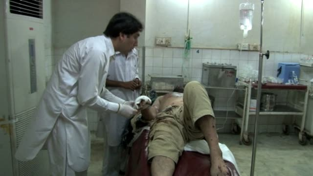 twin bomb attacks on friday killed at least 13 people outside mosques in northwest pakistan where the party of cricket star imran khan is forming a... - peshawar video stock e b–roll