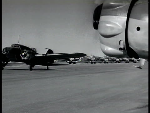 cooperation twin engine bomber taxiing on runway map air routes from chicago over canada to london moscow tokyo vladivostok - 1943 stock videos and b-roll footage