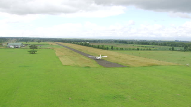 ws aerial ts twin engine plane taking off from runway / kenya - propeller video stock e b–roll