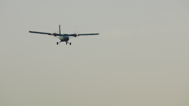 ms pan la twin otter flying against dusk / st. maarten - otter stock videos and b-roll footage