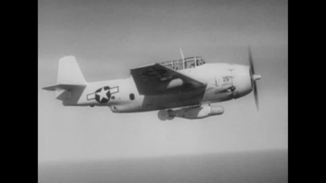 VS twin propeller airplanes with bombs attached to undercarriage fly over the ocean one veers away and dives another flies above the clouds / bomber...