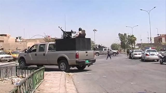 twin suicide bombings killed 31 people after midday prayers at a shiite muslim religious centre in north baghdad on tuesday clean suicide bombers... - midday stock videos and b-roll footage
