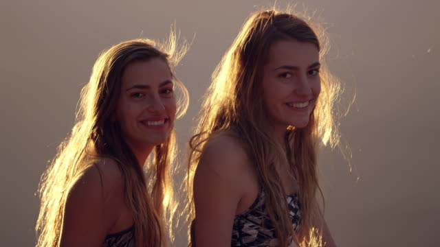 Twin teenage girls having fun as one tries to flirt