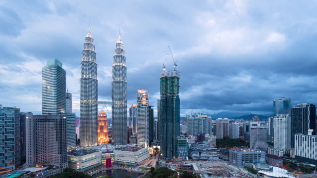 Twin Towers and KLCC park day to night