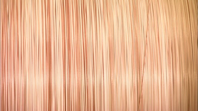 twined copper wire rests in a roll. - woven stock videos & royalty-free footage