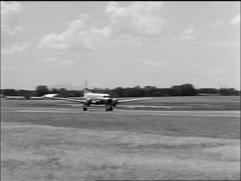 b/w 1957 pan twin-prop continental airliner taking off - 1957 stock videos & royalty-free footage