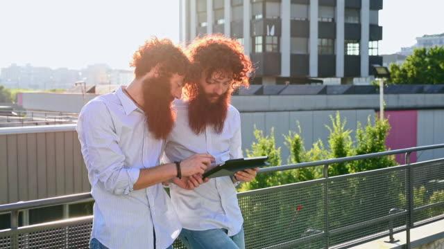 Twins using digital tablet