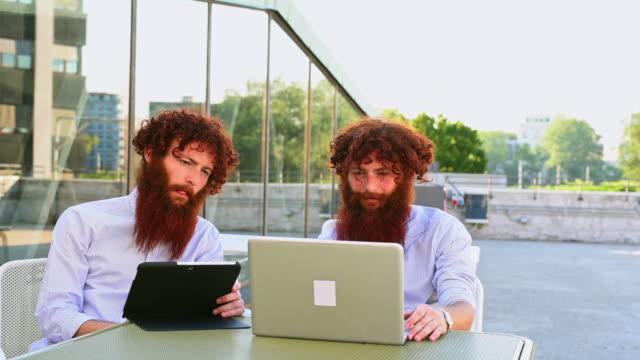 twins using laptop - vanguardians stock videos & royalty-free footage
