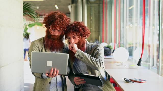 Twins using laptop