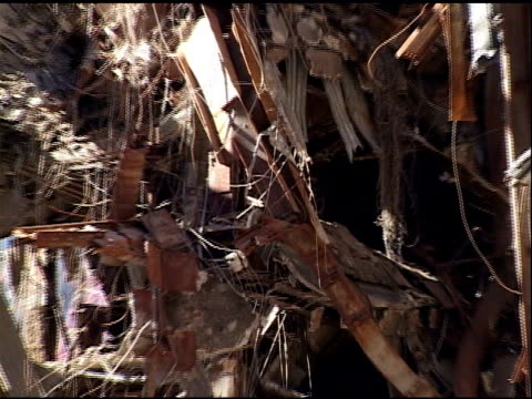 twisted steel & metal debris to show heavily damaged building at; ground zero, wtc, october 2001. second damaged facade of building. - 2001 bildbanksvideor och videomaterial från bakom kulisserna