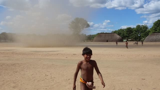 A twister runs through the village centre in Kamayura shot on June 14th 2014
