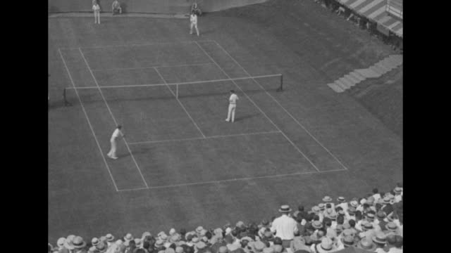 two action shots of men's doubles match at forest hills between partners bill tilden and bill johnston in far court and partners vincent richards and... - davis cup stock-videos und b-roll-filmmaterial