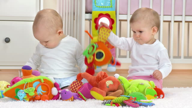 stockvideo's en b-roll-footage met hd: two adorable toddlers playing with toys - alleen baby's