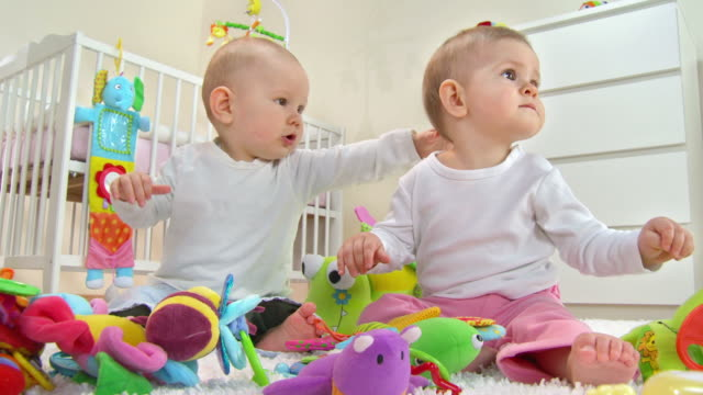 hd: two adorable toddlers playing with toys - baby boys stock videos & royalty-free footage