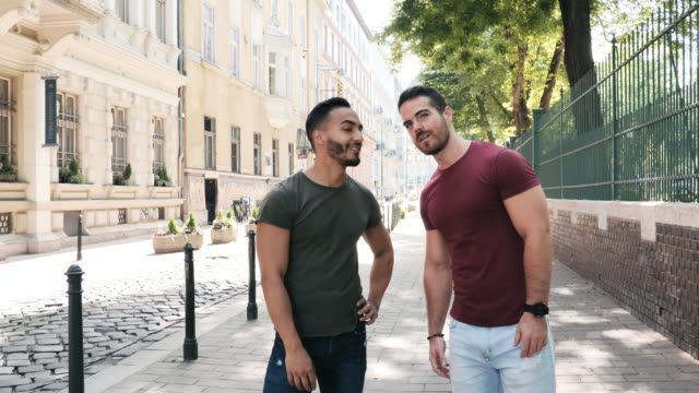 two adult men enjoying visiting 8th district of budapest - eastern european culture stock videos & royalty-free footage