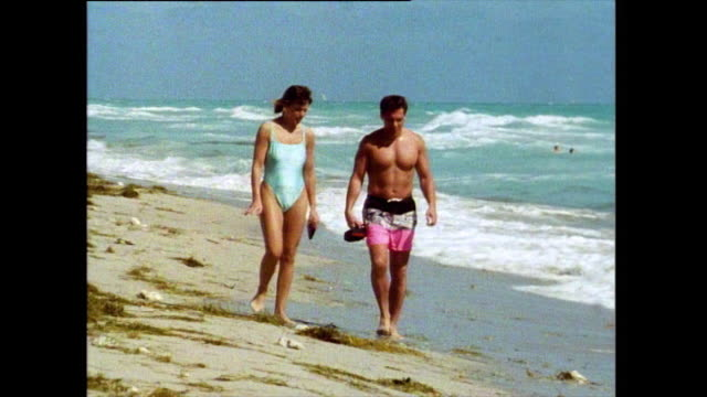 two adults and group of children on beach in miami; 1991 - semi dress stock videos & royalty-free footage