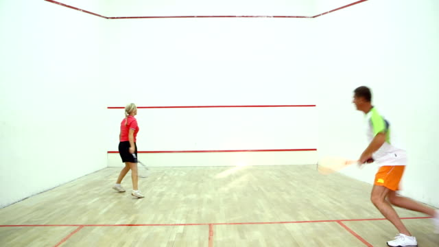 two adults playing squash. - serving sport stock videos and b-roll footage