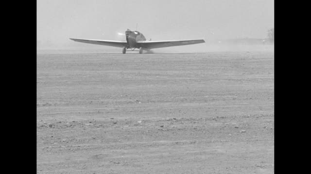 "two aerial shots of ""bremen"" landing at airfield in cleveland / shot on ground of ""bremen"" landing / ""bremen"" taxiing towards camera / german pilot... - looking at camera stock videos & royalty-free footage"