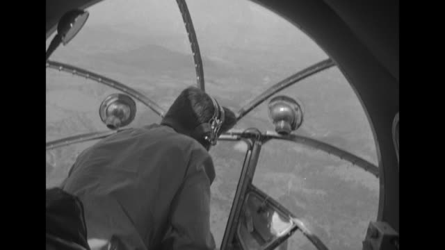 Two aerial shots of mountains below / shot from plane of bombers flying in formation / shot inside plane of pilot in cockpit / shot inside plane of...