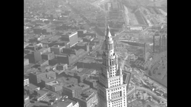 two aerial shots of terminal tower / two aerial shots of terminal buildings / wide ground level shot of terminal / pan across terminal building / two... - paramount building stock videos and b-roll footage