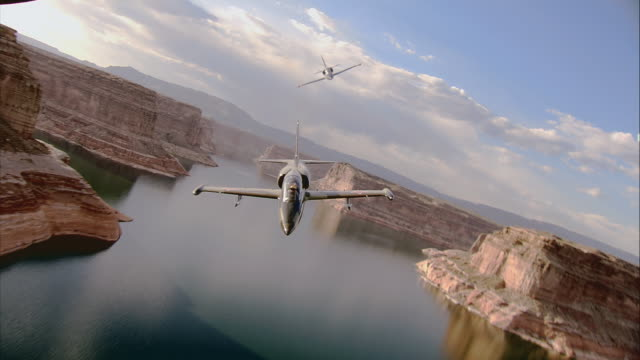 air to air, two aero l-39 albatroses flying over grand canyon and lake, arizona, usa - military aeroplane stock videos and b-roll footage