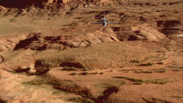 air to air, ws, two aero l-39 albatroses flying over grand canyon and lake meade, arizona, usa - canyon lake stock videos & royalty-free footage