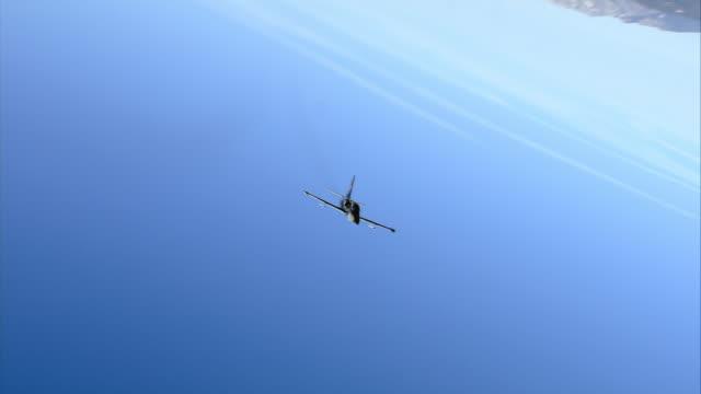 AIR TO AIR, Two Aero L-39 Albatroses flying over Mojave Desert hills, California, USA