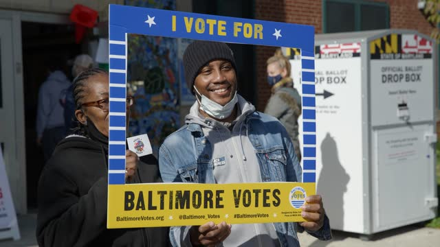 two african american voters pose for a photo on election day in baltimore maryland - black ethnicity stock videos & royalty-free footage