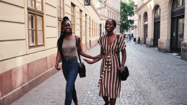 two african women going for a dessert and coffee in famous cafe in budapest. - europe tourist stock videos & royalty-free footage