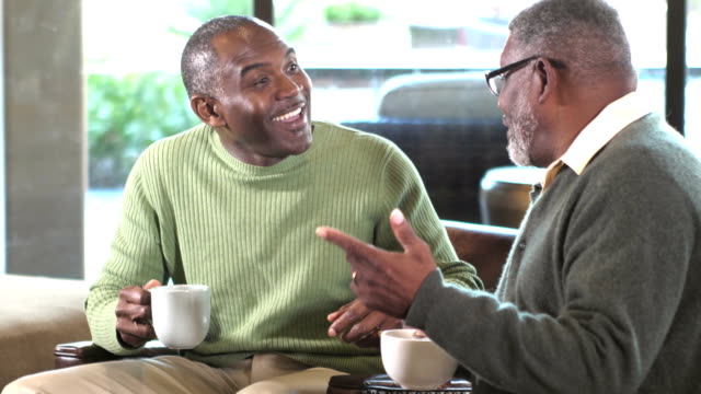 two african-american men talking over coffee - clubhouse stock videos & royalty-free footage