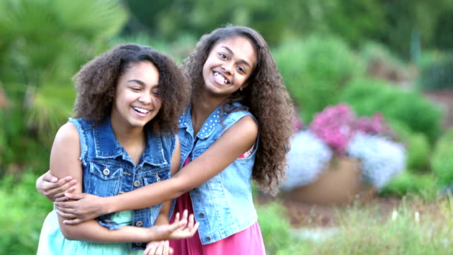 two african-american sisters smiling in garden - sibling stock videos and b-roll footage