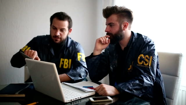 two agents in the office. fbi and csi - fbi stock videos & royalty-free footage